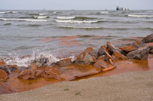 Oil in the Gulf washing ashore. Photo credited to archives.gov
